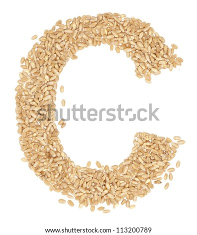 C, Alphabet from dry wheat berries. - stock photo