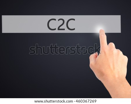C2C - Hand pressing a button on blurred background concept . Business, technology, internet concept. Stock Photo