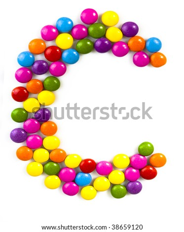 C - Letter of alphabet made of candy isolated on white background - stock photo