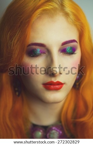 C?lose-up portrait of face. Young beautiful, bright, attractive, mysterious, girl, model, woman, lady, teenager, queen, princess, fairy tale. Creative make-up, bright eyes, red lips. Informal style  - stock photo