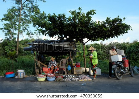 CA MAU, VIET NAM- JULY 15, 2016: Roadside food stalls, outdoor fish market at Mekong Delta countryside, vendor sell seafood as fish, oyster, shrimp, Camau, Vietnam