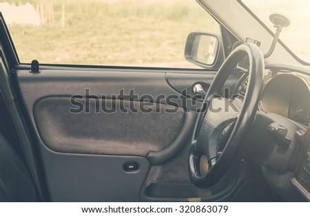 CaAuto car interior with selective focus, soft sun light and vintage filter - stock photo