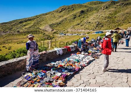 CABANACONDE, PERU - MAY 13, 2015: Unidentified women selling souvenirs at Cruz Del Condor viewpoint. - stock photo