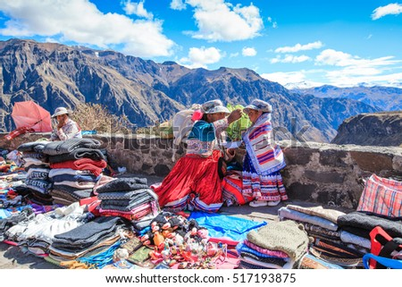 CABANACONDE, PERU - MAY 15 2015: Unidentified women selling souvenirs at Cruz Del Condor viewpoint.