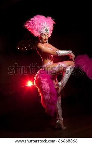 cabaret dancer over dark background - stock photo