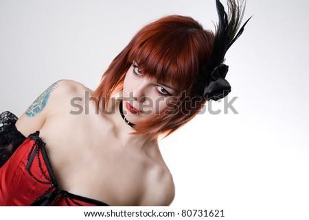 Cabaret girl with hair fascinator, studio shot on white background - stock photo