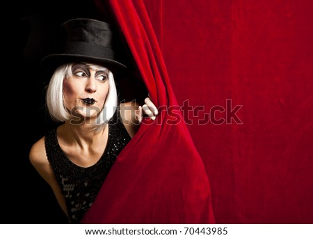 cabaret performer on stage looking at the audience - stock photo