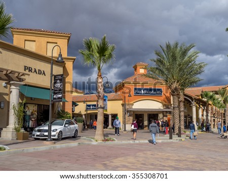 CABAZON, CA - NOV 2015: Desert Hills Premium Outlet Mall on November 15, 2015 in Cabazon California. Desert Hills Premium Outlet Mall is prime destination for tourists visiting Palm Springs. - stock photo