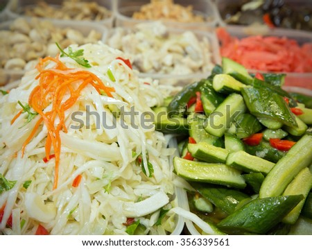 Cabbage and pickled cucumbers on the background of of pickled of salads - stock photo