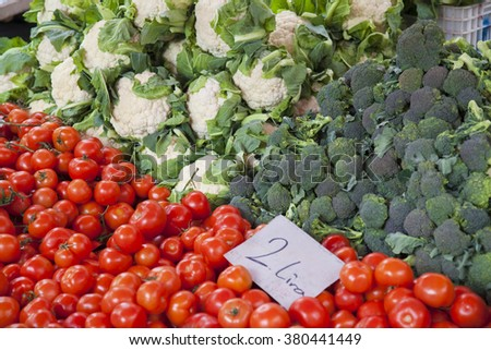 Cabbage, broccoli and tomatoes at the market. - stock photo