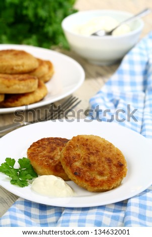 Cabbage cutlets with sour cream on the table