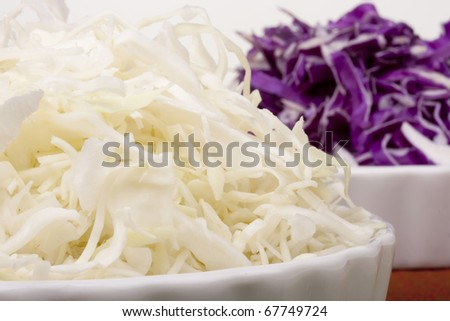 Cabbage finely chopped as an ingredient for salad.