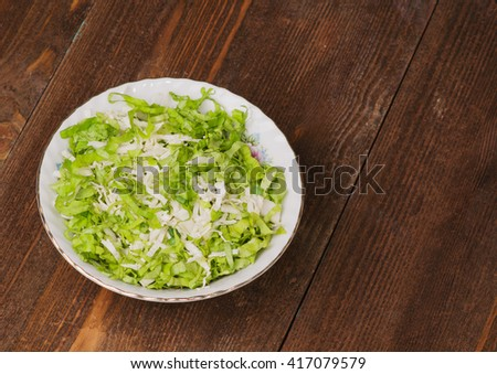 cabbage salad in a plate on a wooden table. Rustic style . - stock photo