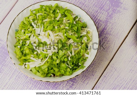 cabbage salad in a plate on a wooden table. Rustic style . Free space for text. - stock photo