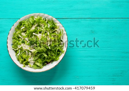 cabbage salad in a plate on a wooden table. Rustic style . Top view.  - stock photo