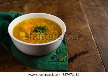 Cabbage soup on a brown, vintage table - stock photo