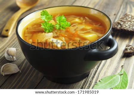 Cabbage soup with meat. Russian traditional dish - stock photo