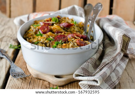 Cabbage stew with lentils and sausages - stock photo
