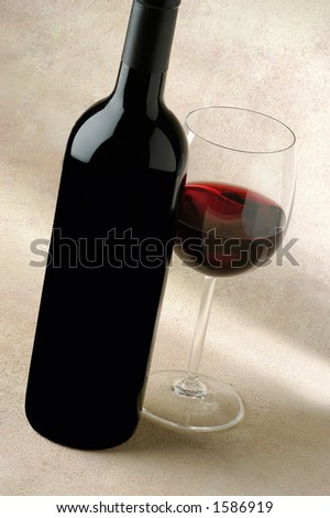 cabernet,bottle and glass,nice red glow in the glass - stock photo