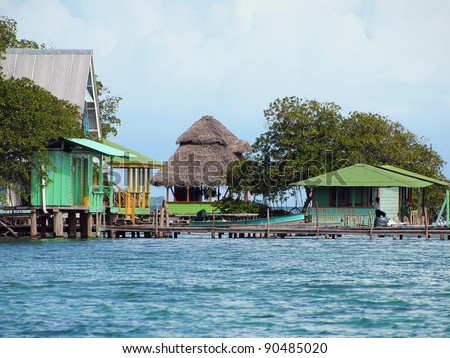 Cabin and houses over water with mangrove trees, Caribbean sea, Cayo coral, Bocas del Toro, Panama - stock photo