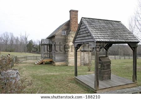 cabin and well-house - stock photo
