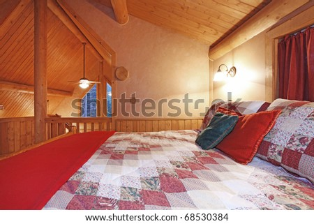 Cabin bedroom with large log and unusual architecture - stock photo