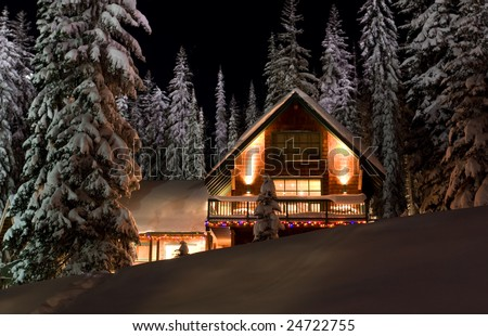 Cabin in Snow Covered Forest - stock photo