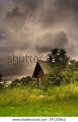 Cabin In The Middle Of Scenic Landscape - stock photo