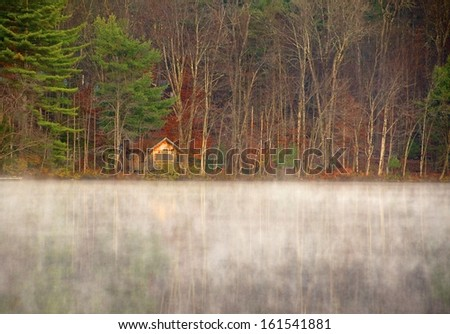 Cabin is nestled in the woods on a peaceful Adirondack morning - stock photo