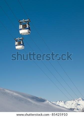 Cabin lift of a ski resort - stock photo