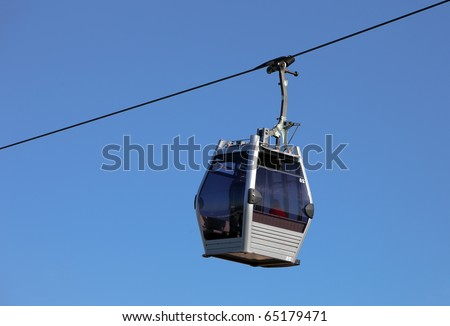Cabin of a gondola lift climbing on its steel cable