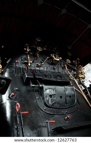 Cabin of a steam train locomotive - stock photo