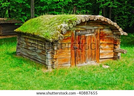 cabin of poor peasant in a national park Pirogovo (Ukraine) - stock photo