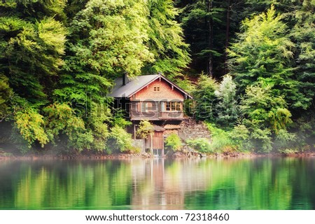 Cabin on a Bavarian lake - stock photo