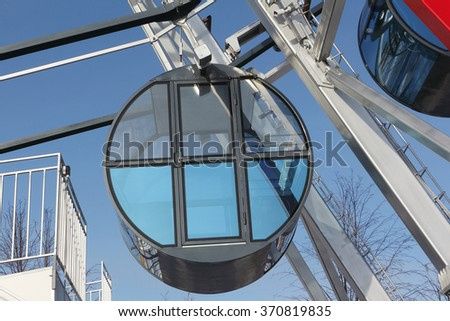 Cabin the ferris wheel against the blue sky - stock photo