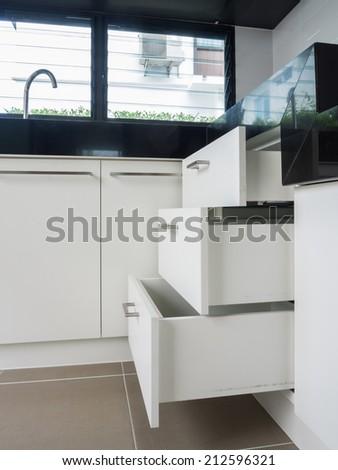 Cabinet drawer detail , modern kitchen interior design - stock photo