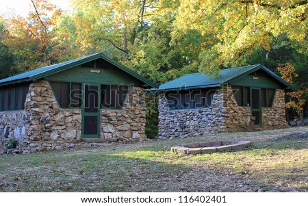 Cabins at very old Boy Scout camp built in 1916 on South Fork of Spring River in Hardy Arkansas. Each building is named for an Indian Tribe.  These are Navajo and Choctaw. - stock photo