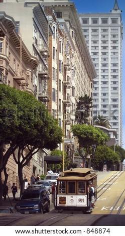 Cable car glides down a steep San Francisco street - stock photo