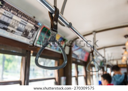 Cable Car Handles for standing passenger inside a bus - stock photo