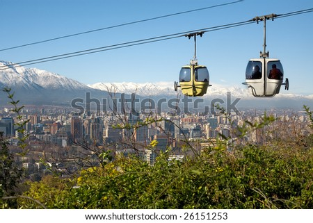 Cable car in San Cristobal hill, overlooking a panoramic view of Santiago de Chile - stock photo