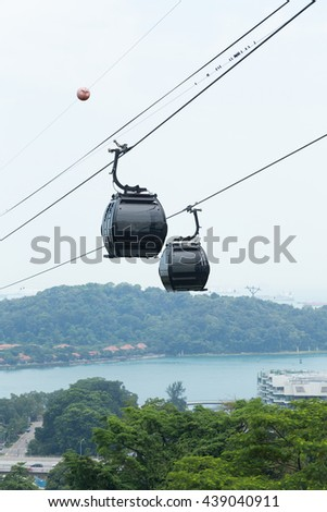 cable car in sinagapore. transport people travel in mountain. - stock photo