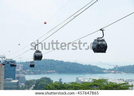 cable car in sinagapore. transport people travel in mountain.