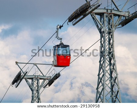 Cable car over the clouds in Swiss Alps