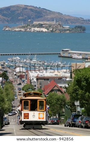 Cable Car with Alcatraz in the background, San Francisco - stock photo