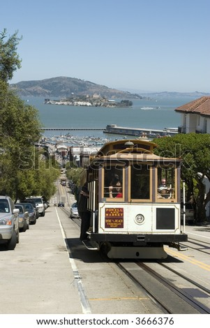Cable Car with Alcatraz in the Background San Francisco California - stock photo