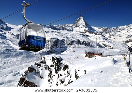 Cable car with ski slope in mountains near Zermatt, Switzerland. Swiss Alps with Matterhorn (peak Cervino),  train and ski lift. - stock photo