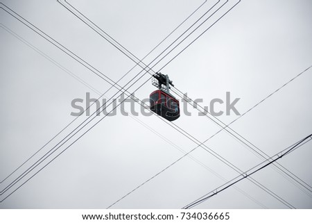 Cable cars and wires  October 3, 2017 in a fishing village in Korea. Cable cars and wires made a line in the sky.