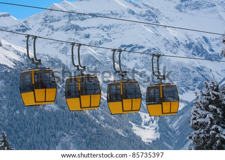 Cable cars on the skiing resort Braunwald. Switzerland - stock photo