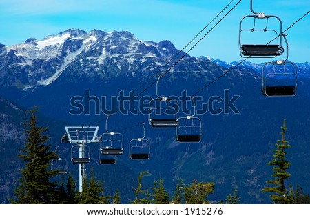 Cable carts / Gondola and snow peaks of Blackcomb Mountains. More with keyword group14l