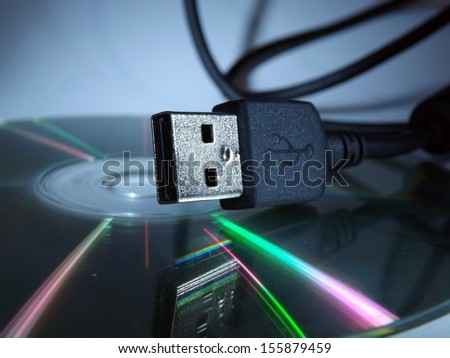 Cable data and CD - stock photo